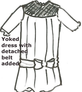 antique doll dressed yoked with belt